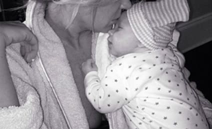 Kim Zolciak Cuddles with Twin, Loves Life