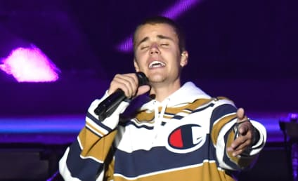 Justin Bieber Wears World's Worst Disguise, Blows Snot on Fans
