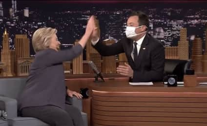 Jimmy Fallon Greets Hillary Clinton with Surgical Mask, Bag of Softballs