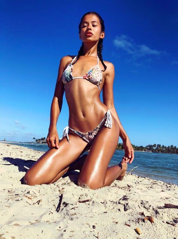 Juliana custodio glistens in the sand