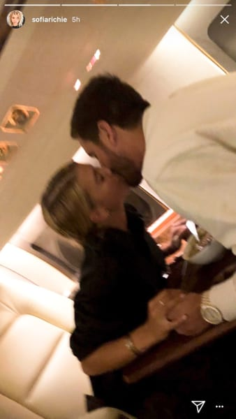 Sofia Richie and Scott Disick, Plane Kiss
