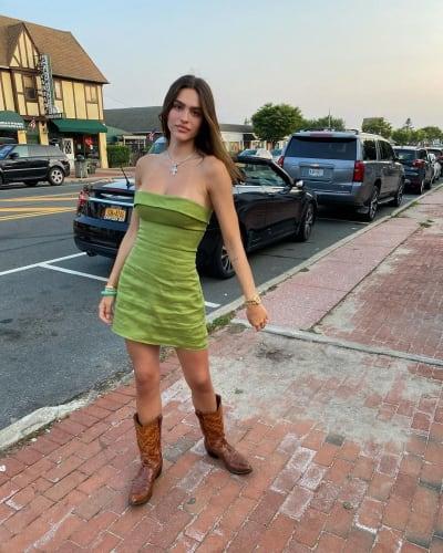 Amelia Hamlin in Boots and a Vivid Yellow-Green Dress