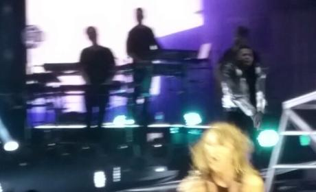 Taylor Swift Nearly Gets Snatched Off Stage, Recovers Like a Pro