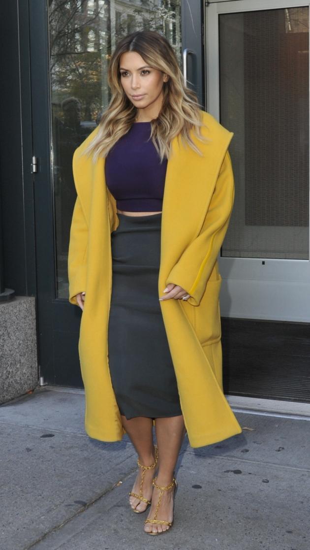 Kim Kardashian with Yellow Coat
