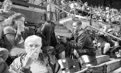 Old Lady Flips Off Camera, Ruins Couple's Ballpark Engagement Photo