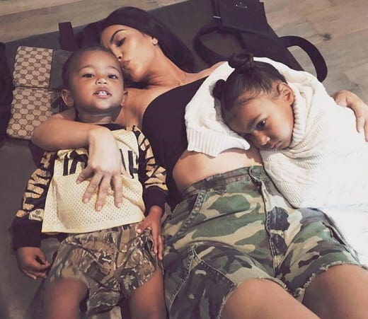 Saint West, Kim Kardashian, North West on the Eclipse