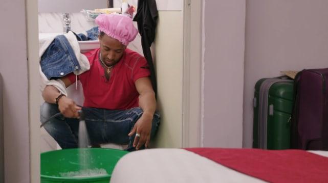 Biniyam shibre does laundry by hand
