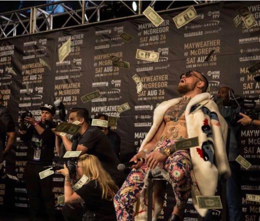 Mayweather Makes It Rain on McGregor